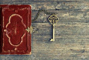 43391104-antique-bible-book-and-golden-key-on-wooden-background-vintage-still-life-stock-photo